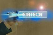 Konceptuální rukopis ukazující Fintecha. Firemní foto představení počítačových programů a další technologie podporující finanční služby.