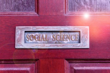 Handwriting text writing Social Science. Concept meaning scientific study of huanalysis society and social relationships Old retro mailbox on the wooden doors. Hole on the wooden doors for mail.