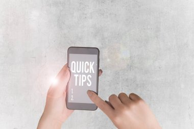 Handwriting text Quick Tips. Concept meaning small but particularly useful piece of practical advice.