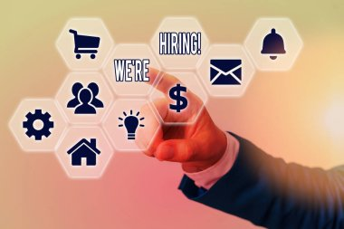Word writing text We are Hiring. Business concept for process of reviewing applications and finding candidates.