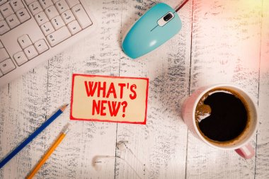 Text sign showing What New Question. Conceptual photo when you ask someone about his current live events actions technological devices colored reminder paper office supplies keyboard mouse.