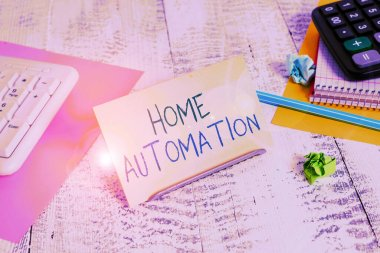 Conceptual hand writing showing Home Automation. Business photo text home solution that enables automating the bulk of electronic Notepaper on buffer wire in between keyboard and math sheets.