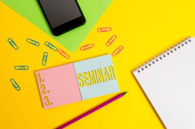 Writing note showing Seminar. Business photo showcasing Conference Academic instruction Class for small students group Square blank sticky notepads pencil smartphone sheet color background.