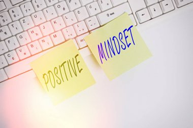 Conceptual hand writing showing Positive Mindset. Business photo showcasing mental and emotional attitude that focuses on bright side Square green note paper with pencil on the white background.