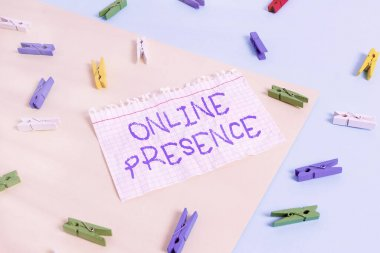 Word writing text Online Presence. Business concept for existence of someone that can be found via an online search Colored clothespin paper empty reminder yellow blue floor background office.