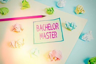 Conceptual hand writing showing Bachelor Master. Business photo showcasing An advanced degree completed after bachelor s is degree Colored crumpled paper empty reminder blue yellow clothespin.
