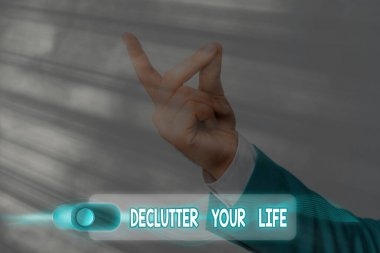 Text sign showing Declutter Your Life. Conceptual photo To eliminate extraneous things or information in life.
