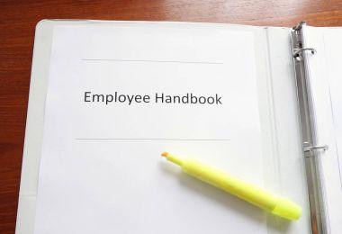 Employee Handbook on a desk