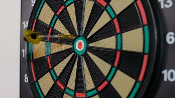 A dart arrow stick on the dart board.