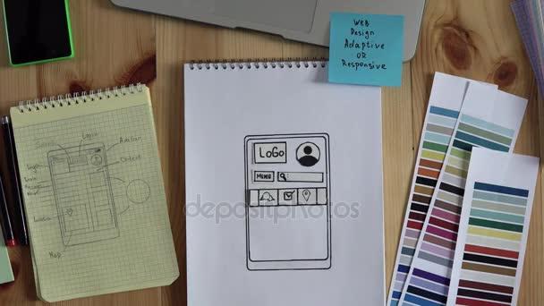 Die Web-Entwickler macht das Layout der Website auf seinem Notebook. Gefilmt in Stop-motion.