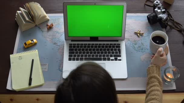 Top view world map on the table a woman planning a vacation a top view world map on the table a woman planning a vacation a gumiabroncs Image collections
