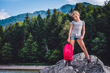Little hiker with backpack