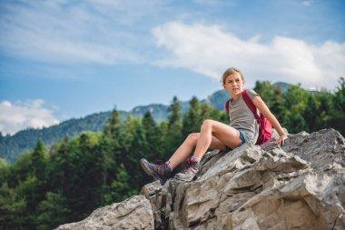 Hiker descends the mountain peak