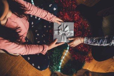 Girls giving christmas gift