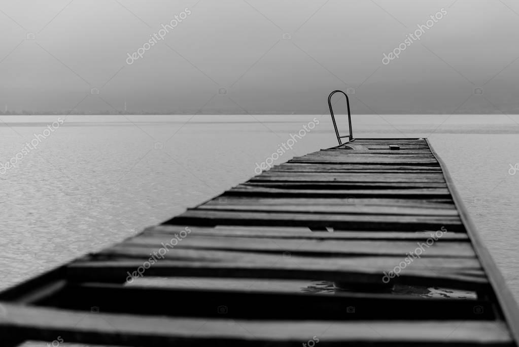Black and white picture of old wooden dock