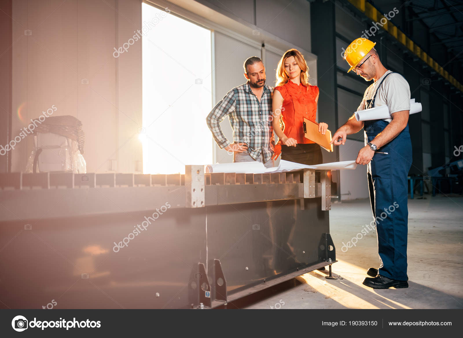 Architect team checking blueprint industrial construction site architect team checking blueprint industrial construction site foto de stock malvernweather Image collections