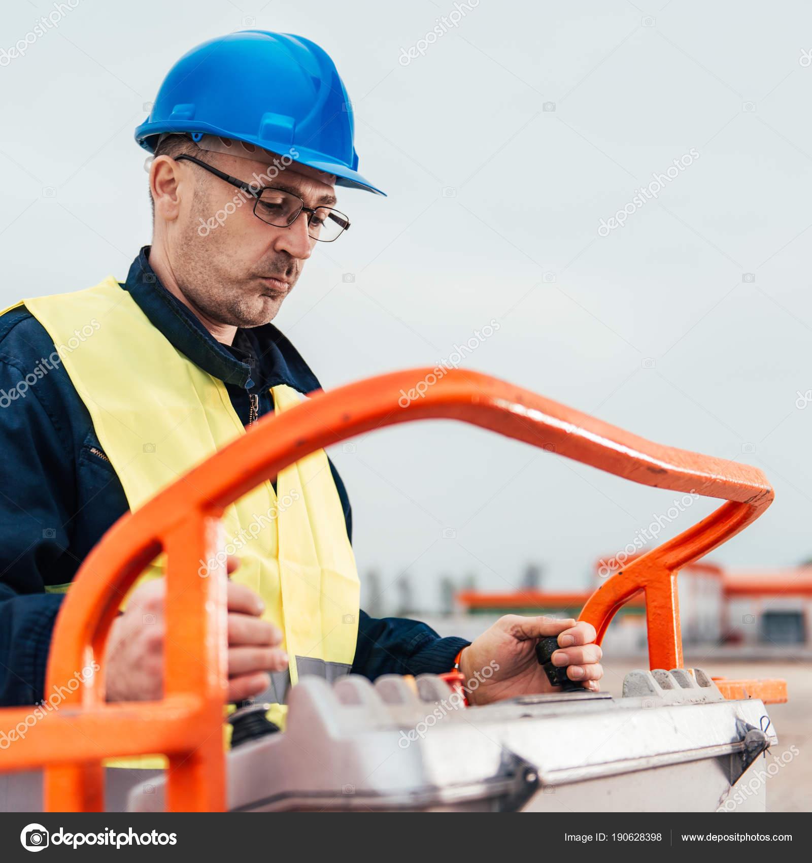 Operator Safety Helmet Controlling Straight Boom Lift — Stock Photo