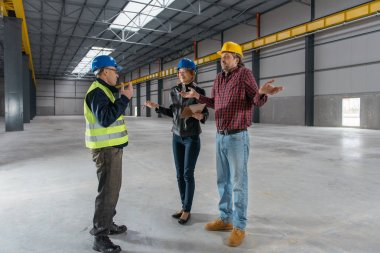 Site Inspector talking with Construction workers