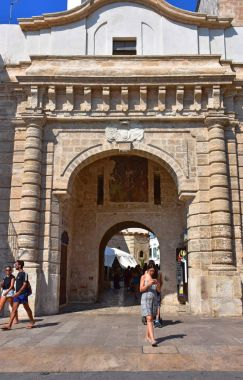 Italy, Puglia region, 18/08/2017, Polignano, tourists at the gateway to the historic center.