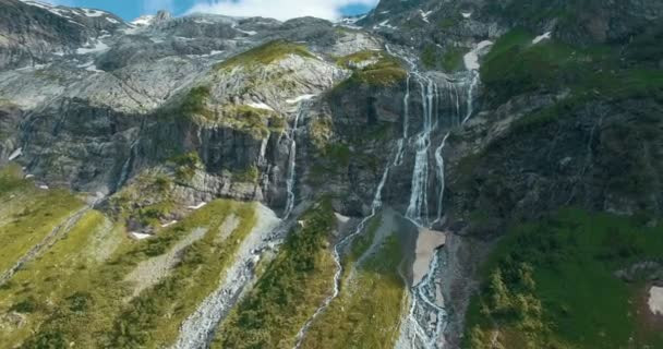 Epic aerial close up of waterfall in beautiful mountains in Greenland