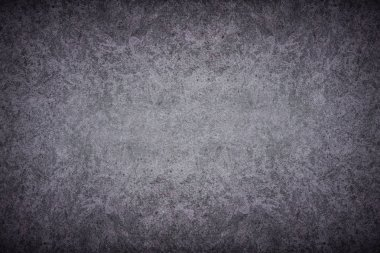 Grey textured concrete wall background. Dark edges