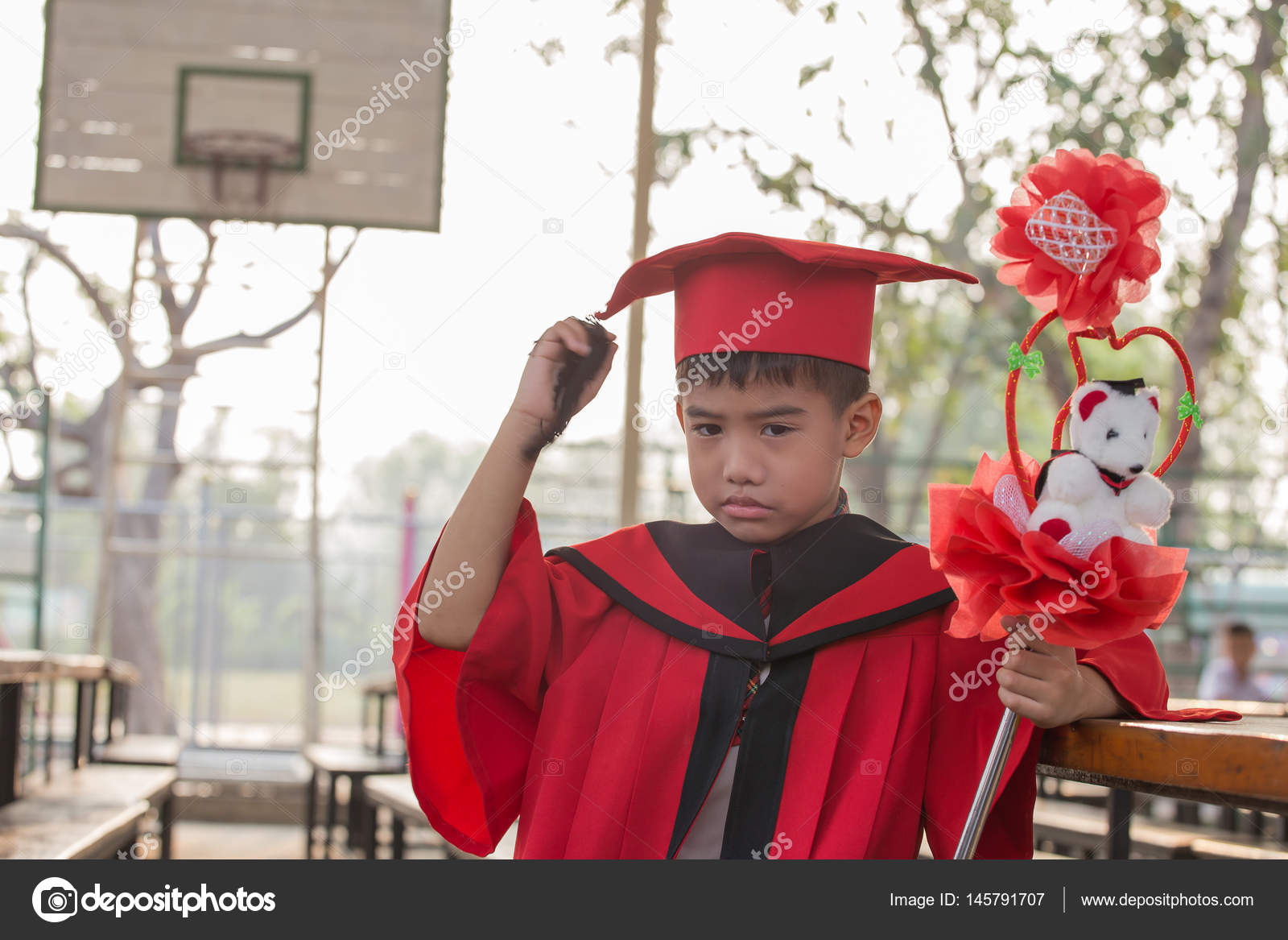 Asian boys face frowning Red graduation gown — Stock Photo ...