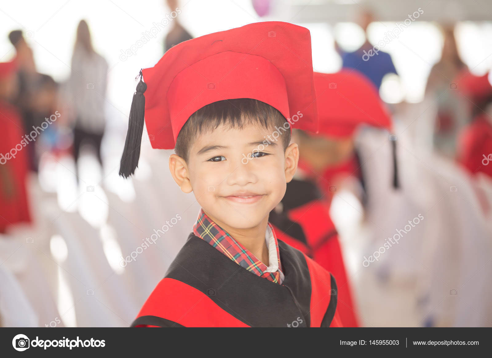 Asian boy Red graduation gown — Stock Photo © photonewman #145955003