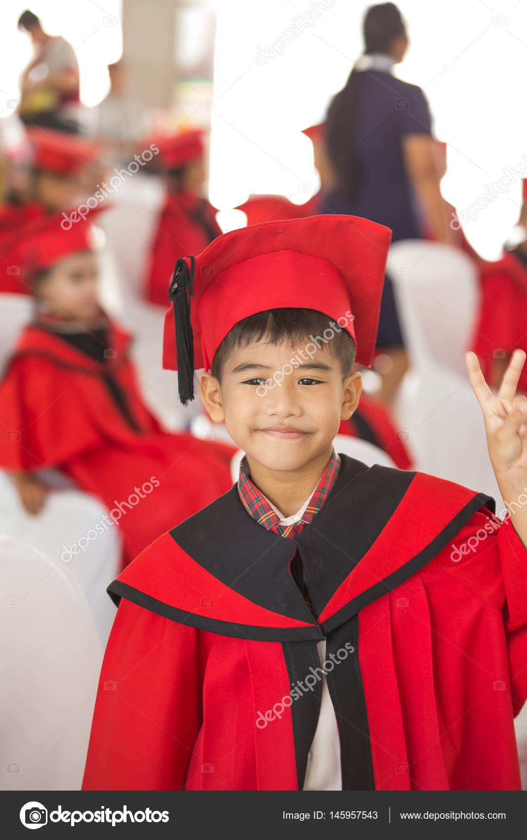 Asian boy Red graduation gown — Stock Photo © photonewman #145957543
