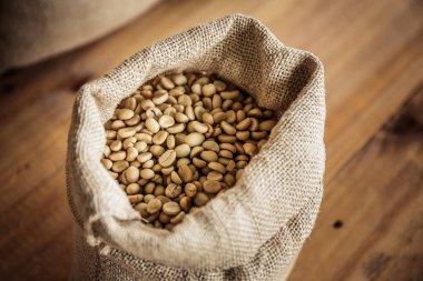 Fresh coffee beans in cloth bags.