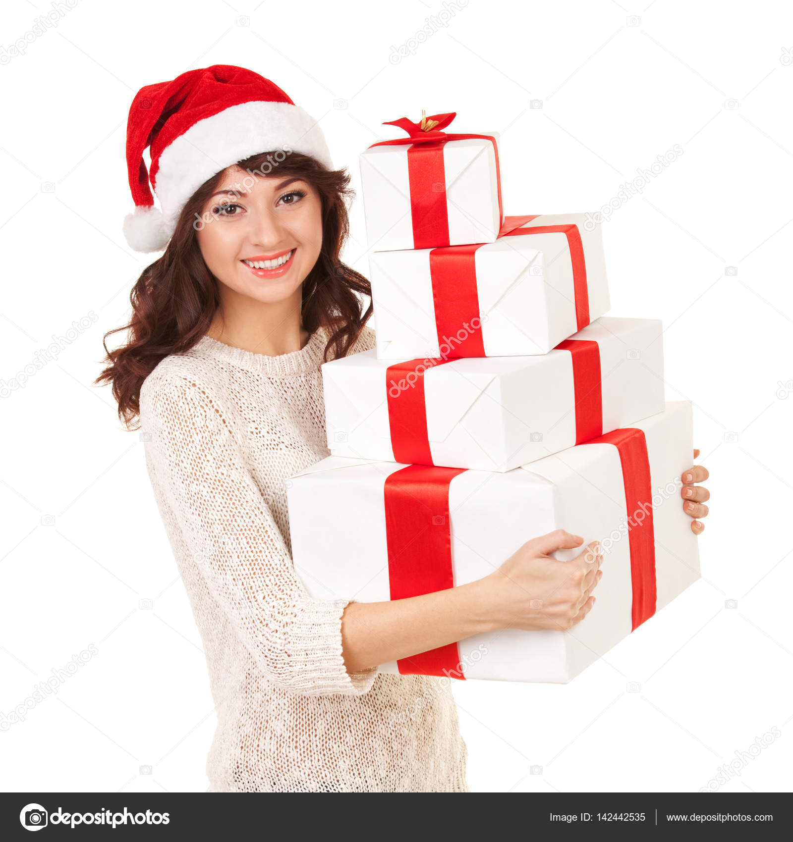 317eb265afaba Happy santa woman with gift boxes isolated on white. Smiling model in santa  hat posing at studio with gifts. Christmas
