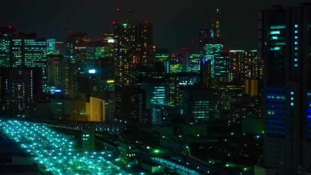 A panoráma éjszakai időintervalluma Tokióban, a nagylátószögű nagyvárosban