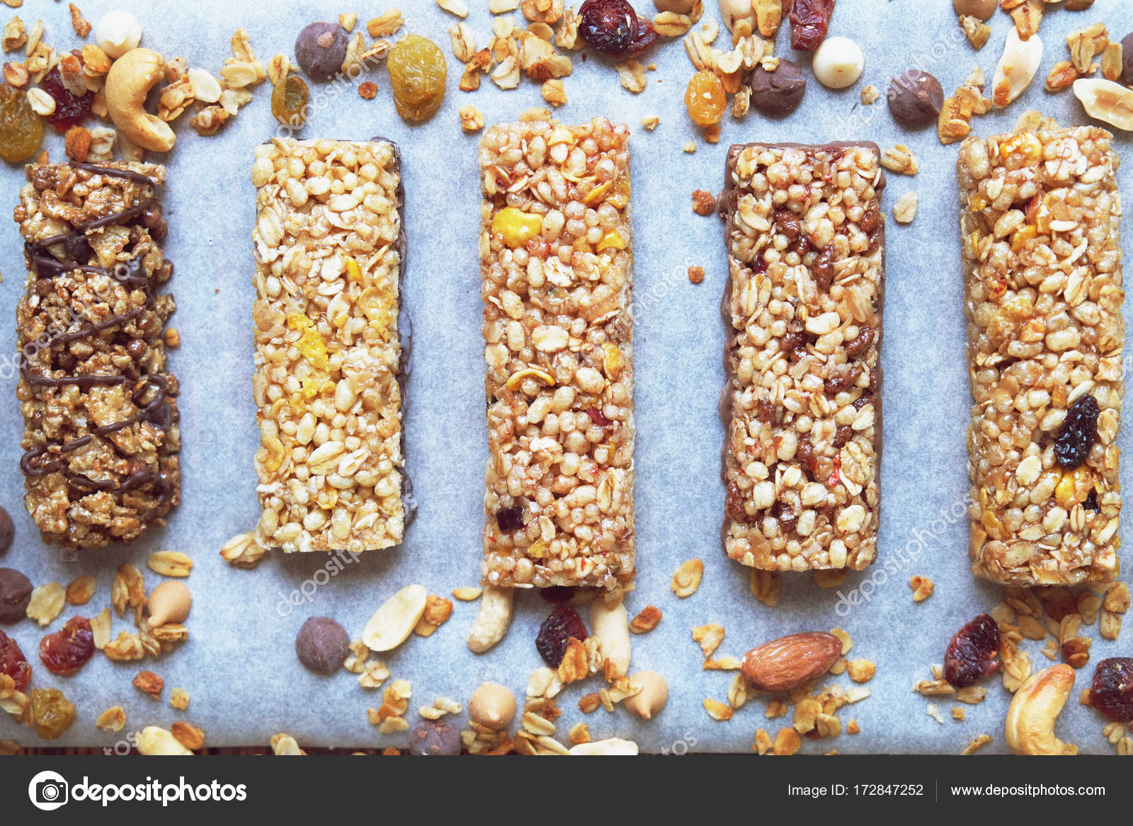 Cereal bars with dry fruits nuts granola and glass of milk on cereal bars with dry fruits nuts granola and glass of milk on wooden backgroundp viewhealthy homemade cereal bars with nuts seeds and dried fruits on ccuart Choice Image