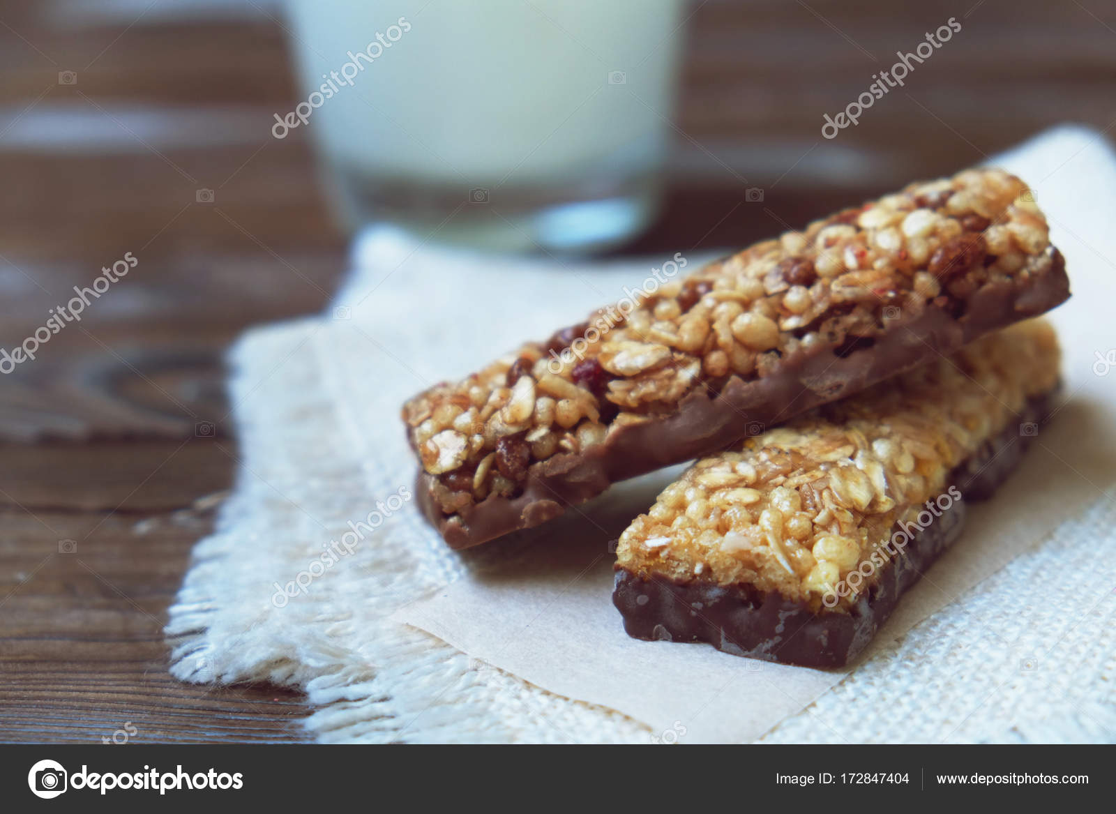 Cereal bars with dry fruits nuts granola and glass of milk on cereal bars with dry fruits nuts granola and glass of milk on wooden backgroundp viewhealthy homemade cereal bars with nuts seeds and dried fruits on ccuart Image collections