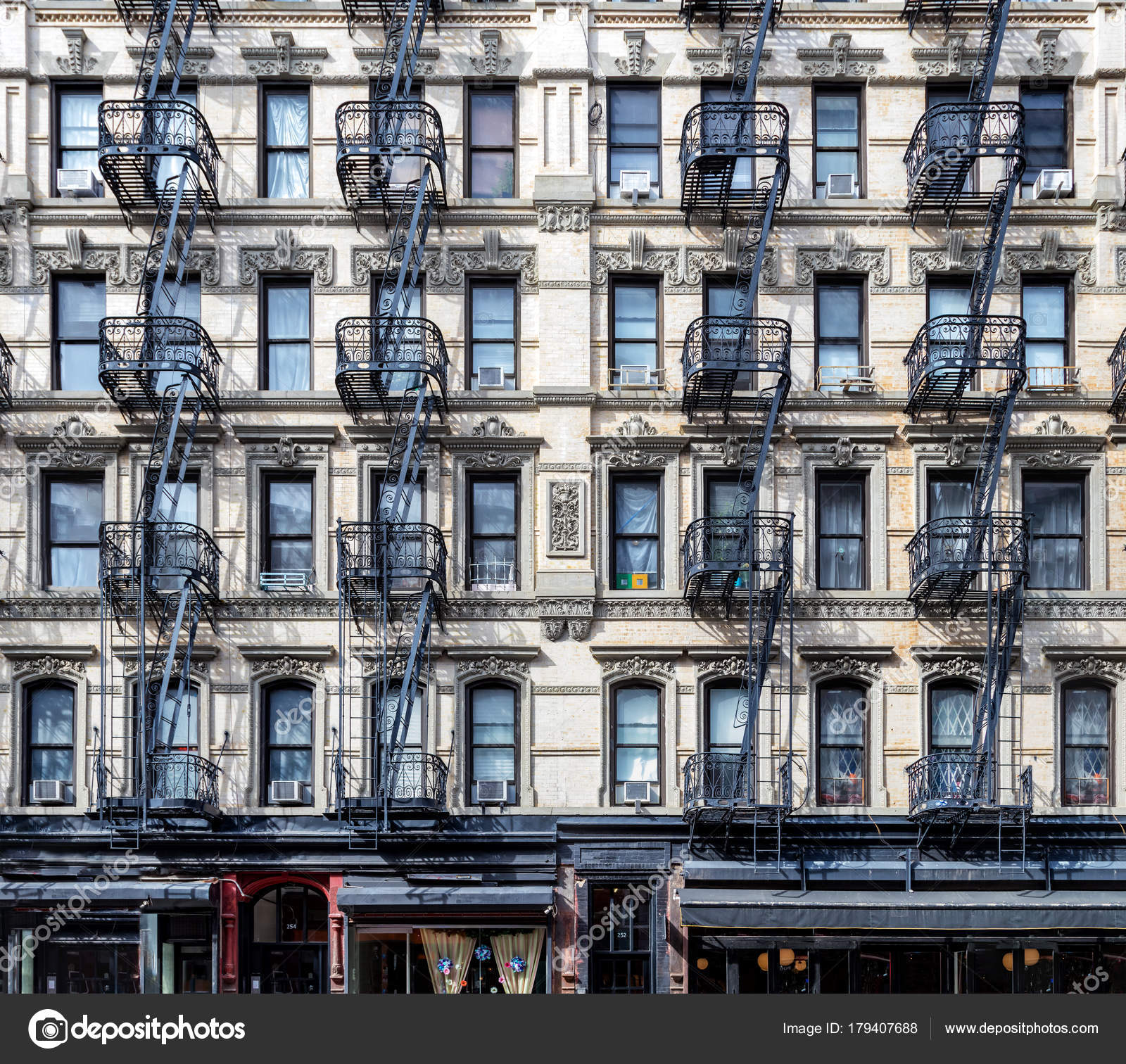 Old Apartment Building: Wall Of Windows On An Old Apartment Building In New York