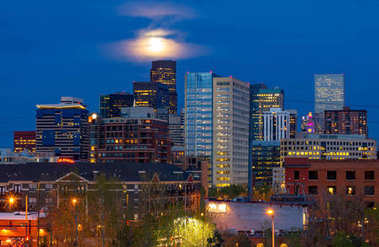 Colorful lights of the Denver Colorado downtown skyline at night