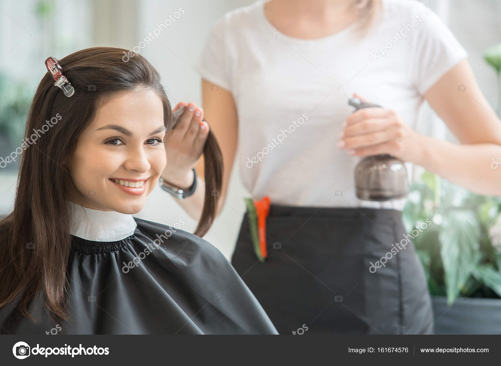 Young Women Sitting In Beauty Hair Salon Style Stock Photo
