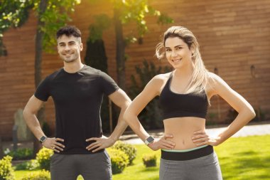 Young couple exercise together outdoors healthy lifestyle