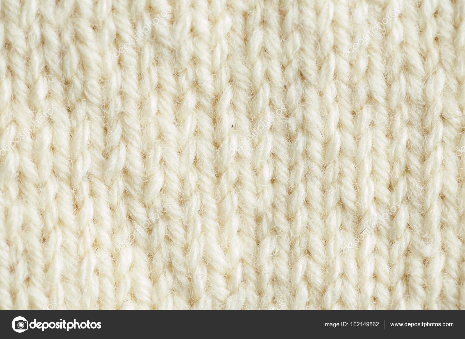 Un bello primer plano de un patrón de punto de lana cálido y suave ...