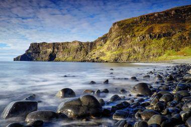 Golden light on cliffs of Talisker Bay, Isle of Skye