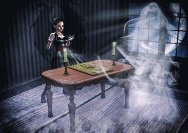 Goth girl summoning a ghost with an Ouija board.