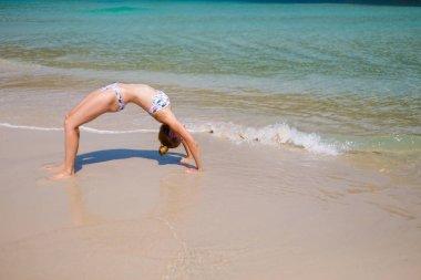Yoga on tropical Thailand beach