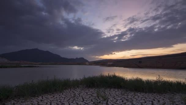 Timelapse dusk hour at Mengkuang dam