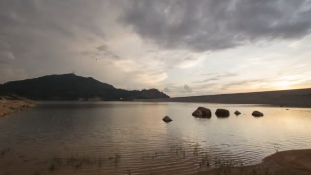 Timelapse sunset over the lake at Mengkuang Dam