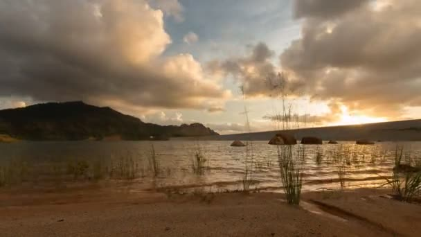 Timelapse sand and lake during dusk.