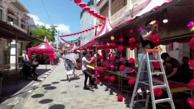Staff decorate the booth prepare for celebration of chinese new year.