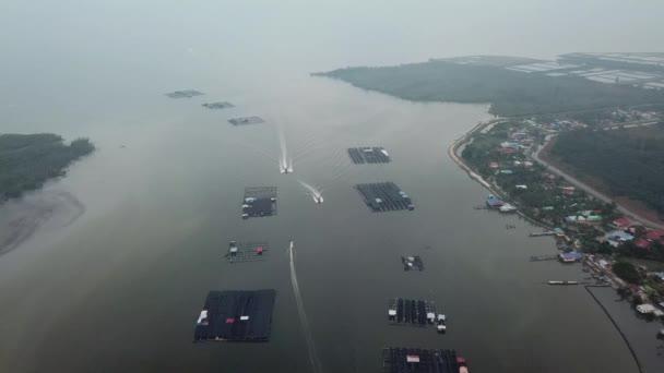 Boats come back from sea at Kuala Kurau fishing village