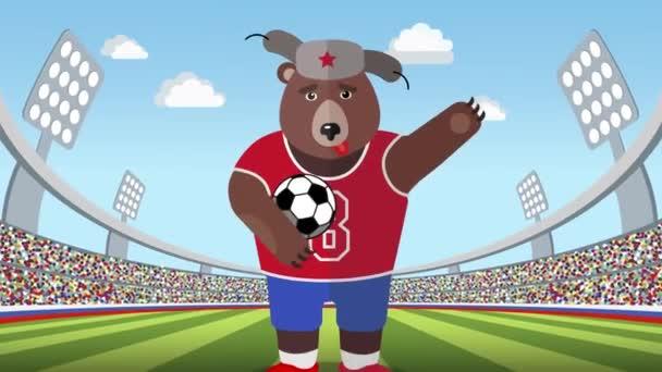 Ruský medvěd s fotbalovým míčem na stadionu detail