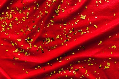 The red background. Glitters. Gold sequins