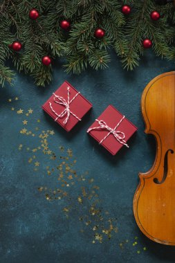 Old violin and fir-tree branches with Christmas decor