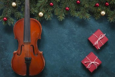 Old violin and fir-tree branches with Christmas decor. Christmas